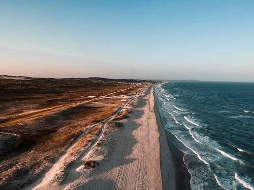 ocean aerial photo of shoreline beside body of water sea