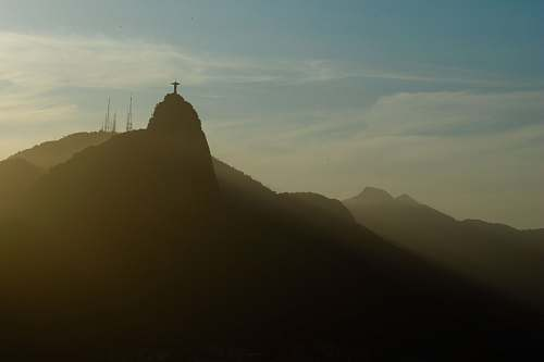 outdoors silhouette of cross on top of mountain at daytime mountain