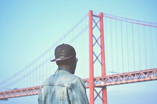 human man looking at the Golden Gate Bridge in San Francisco people
