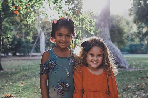 human two dressed children standing against trees people
