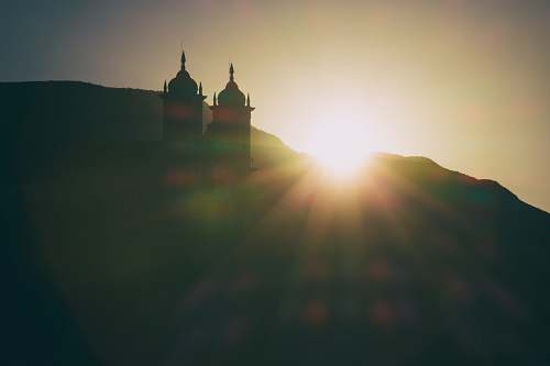 sunset silhouette photo of mosque during golden hour ouro preto
