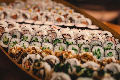 sushi green and white vegetable on brown wooden tray sashimi
