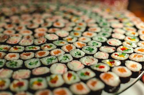 sushi green white and brown round cookies meal