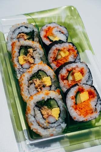 sushi sliced cucumber on white ceramic tray cream