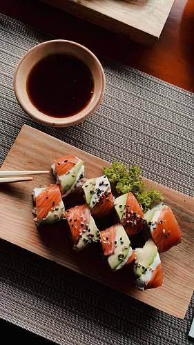 seasoning sushi on white ceramic plate sesame