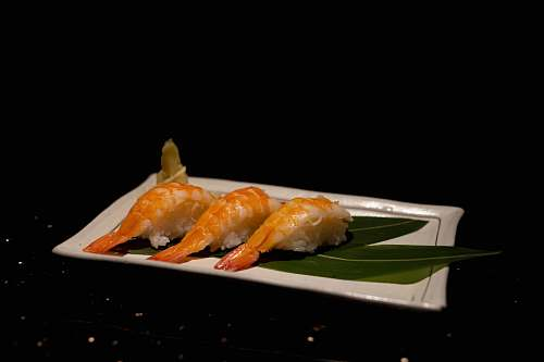 sushi sushi with shrimp on plate brown