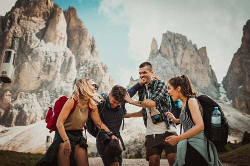 person low-angle photography of two men playing beside two women human