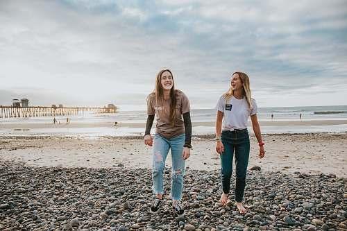 person two women walking on pebbles human