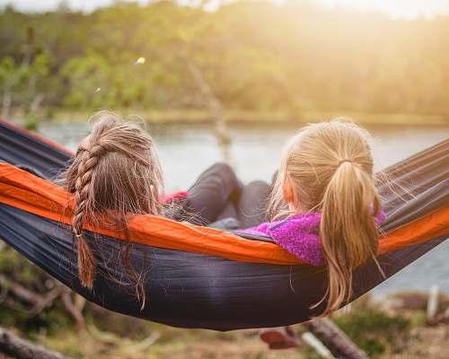 furniture two women lying on hammock hammock