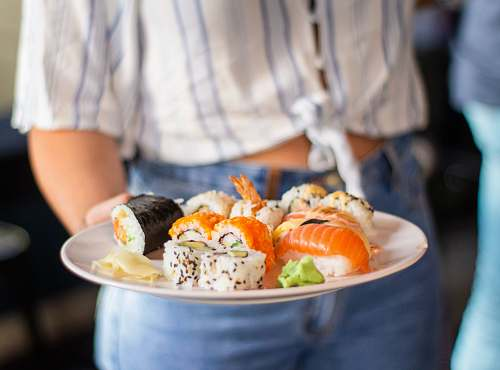 human plate of sushi person