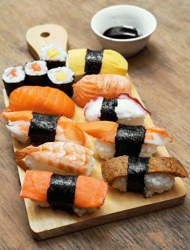 food sushi on wooden platter burger