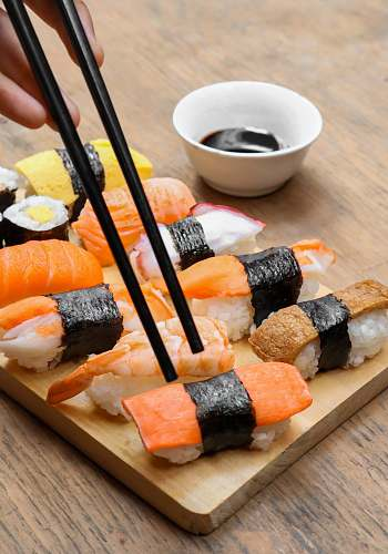 food sushi on wooden tray burger