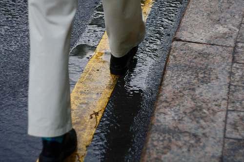 clothing person walking on road footwear