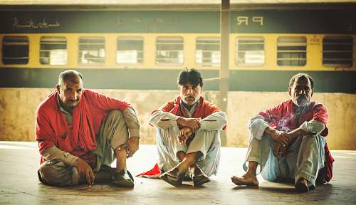 person three men sitting on floor monk