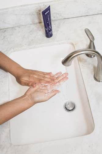 human gray faucet wash
