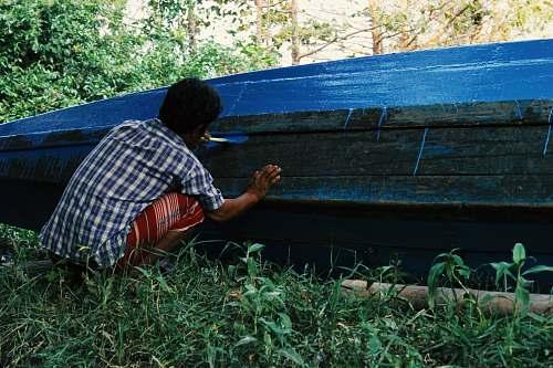 human man painting boat myanmar