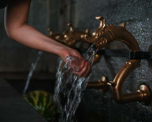human person washing hand on flowing water st. john the forerunner bigorski monastery