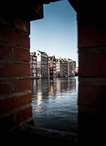 photo netherlands buildings near body of water brick free for commercial use images
