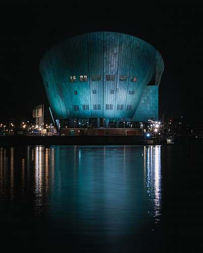 planetarium body of water near building during nighttime architecture
