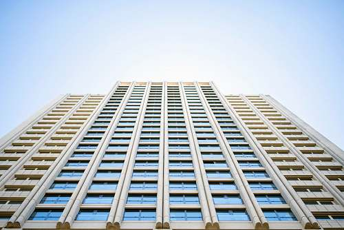 city low angle photography of high rise building during daytime architecture