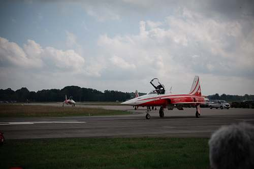 airport red and white jet plane airfield
