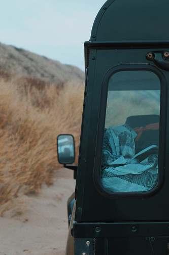 domburg closeup photo of black vehicle near dried grass camper