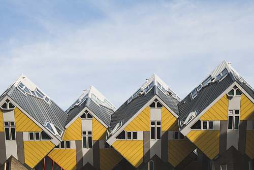 architecture yellow and gray houses roof