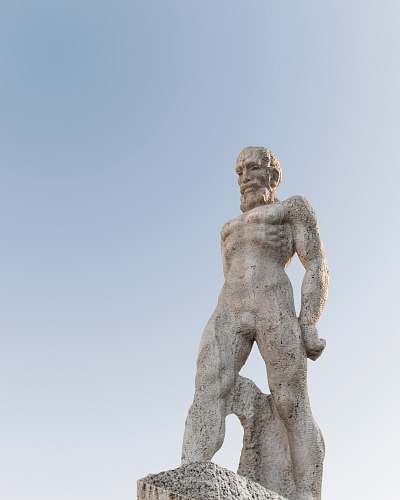 art male statue during daytime sculpture