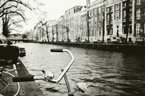outdoors grayscale photo of bicycle canal