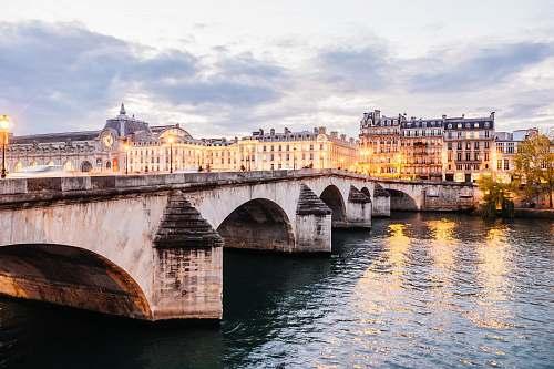 paris bridge near body of water bridge