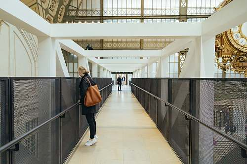 human woman standing near building corridor