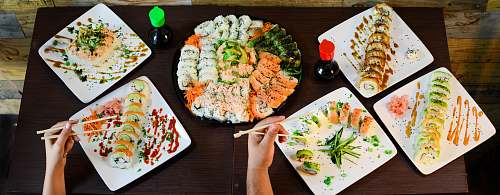 meal assorted sushi on plates on table lunch
