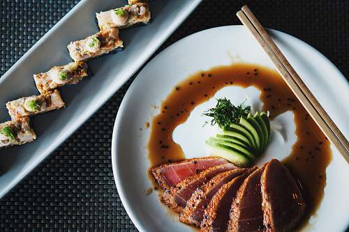 sushi meat with sauce and vegetable plate