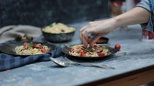 dinner person holding spaghetti sharjah