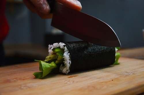 plant shallow focus photo of person cutting sushi ozimska 28