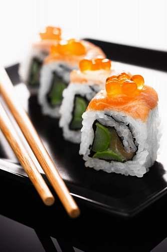 sushi sushi on black ceramic plate burger