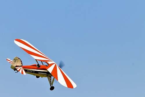 leisure activities white and red monoplane airplane