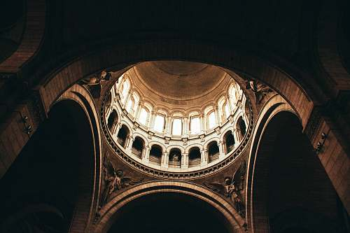 building architectural photography of brown monument interior view paris