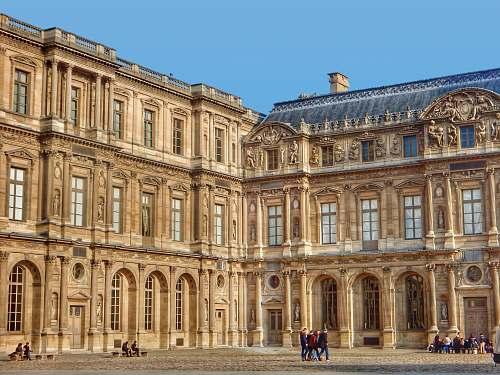 housing brown building during daytime palace