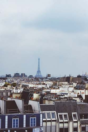 building houses near Eiffel Tower during daytime spire