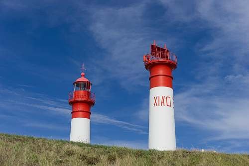 building two white and red towers lighthouse