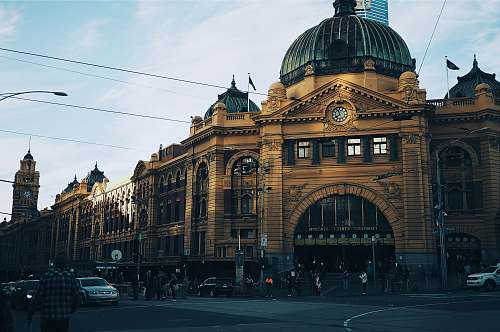 melbourne brown building with cars passing infront building