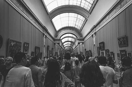 people group of people inside museum in grayscale photography human