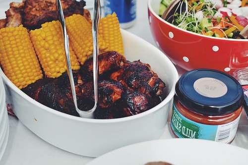 bbq grilled food and corn cob on oval pan salad