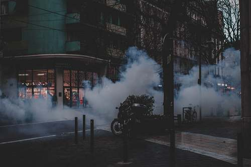 smoke black and gray concrete building during night time motorcycle