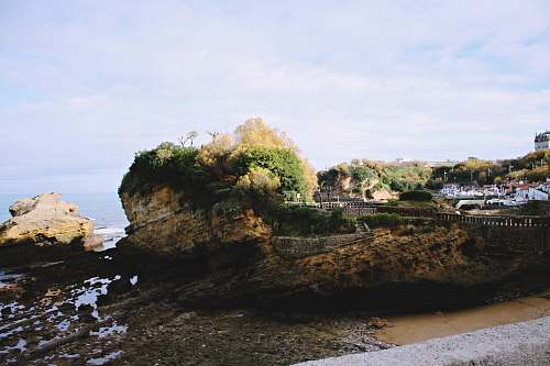 sea rock formation near sea shoreline