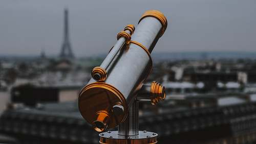 france selective focus photography of gold and gray telescope telescope