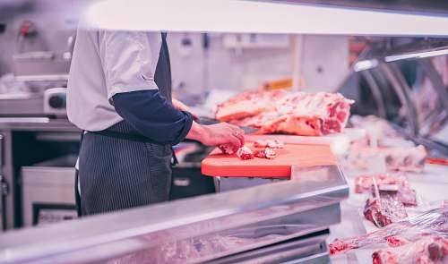 photo human man slicing raw meat shop free for commercial use images