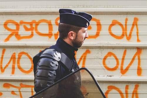 human man wearing police uniform police