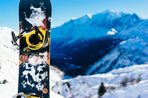 snowboarding shallow focus photography of snowboard sport